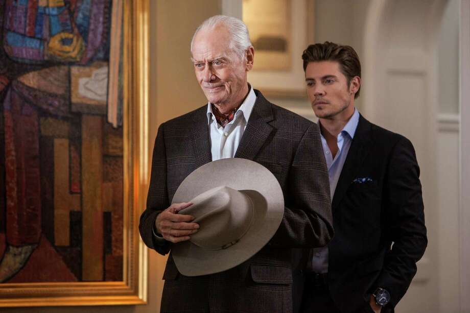 Son John Ross (Josh Henderson, right) lacks the charm of his father, J.R. Ewing (Larry Hagman). Photo: Skip Bolen / TNT