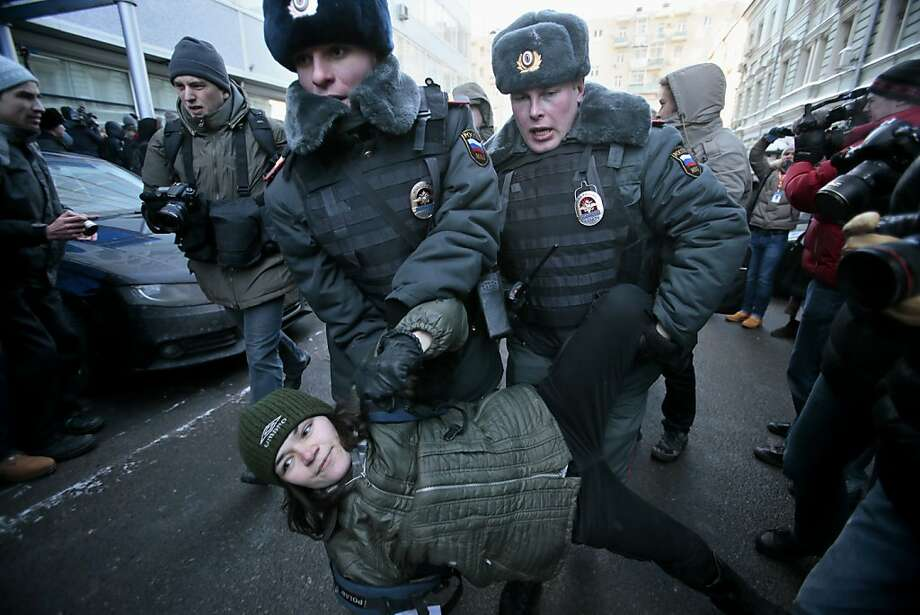 Police detain a demonstrator during a protest in Moscow near Russia's lower house of parliament, where lawmakers gave initial approval to a measure cracking down on gay rights. Photo: Mikhail Metzel, Associated Press