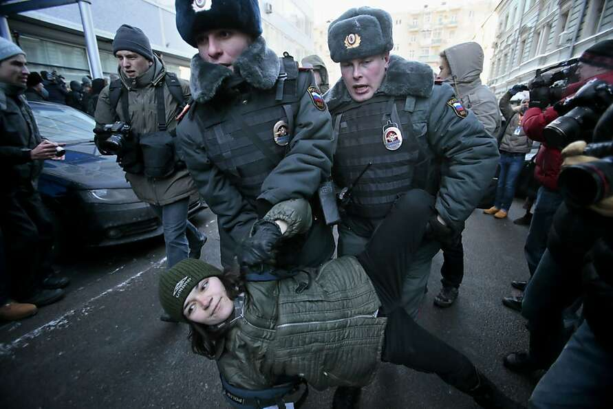 Police detain a demonstrator during a protest in Moscow near Russia's lower house of parliament, whe