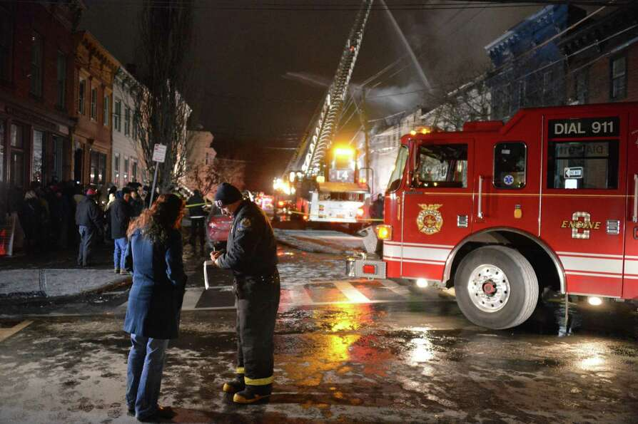 Albany firefighters on the scene of a fire on Dove Street in Albany Friday Jan. 25, 2013.  (John Car