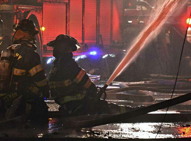 Albany firefighters on the scene of a fire on Dove Street in Albany Friday Jan. 25, 2013.  (John Carl D'Annibale / Times Union) Photo: John Carl D'Annibale