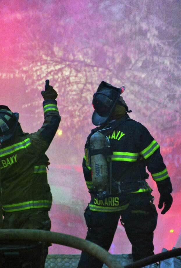 Albany firefighters battle a fire on Dove Street in Albany well into the evening Friday Jan. 25, 2013.  (John Carl D'Annibale / Times Union) Photo: John Carl D'Annibale
