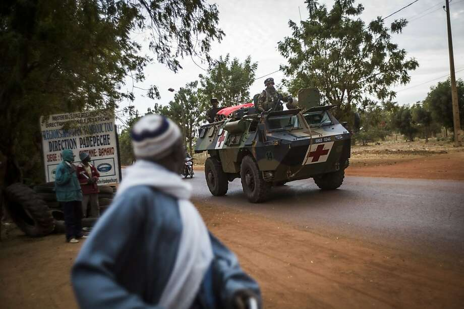French soldiers arrive at a base camp in Sevare. They are working with Malian troops to advance on the key Islamist stronghold of Gao, one of three provincial capitals held by the al Qaeda-backed rebels. Photo: Fred Dufour, AFP/Getty Images