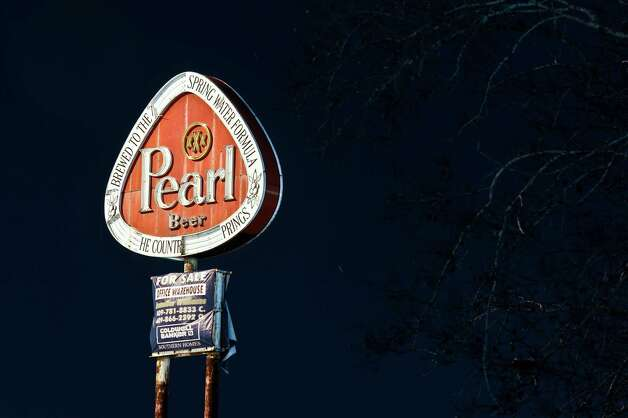 A thirty second exposure of the Pearl Beer sign located on Hollywood Street after dark on January 16, 2013. Photo taken: Randy Edwards/The Enterprise