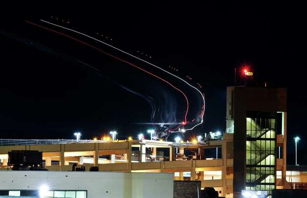 A thirty second exposure of a helicopter leaving CHRISTUS Hospital-St. Elizabeth located on 2830 Calder Street after dark on January 16, 2013. Photo taken: Randy Edwards/The Enterprise