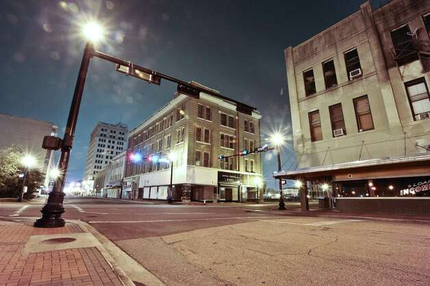 A thirty second exposure of the Bowie Street and Pearl Street intersection in downtown Beaumont on December 5, 2012. Photo taken: Randy Edwards/The Enterprise