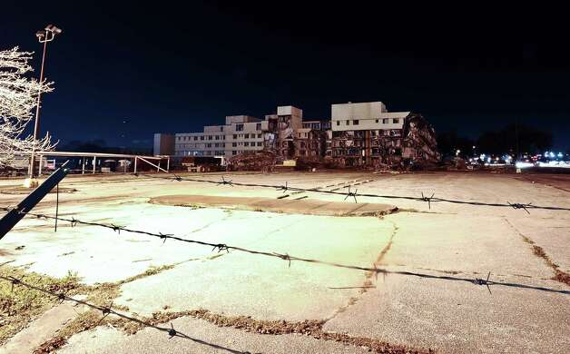A thirty second exposure of the old Baptist Hospital being torn down at the intersection of College Street and 11th Street on January 18, 2013. Photo taken: Randy Edwards/The Enterprise