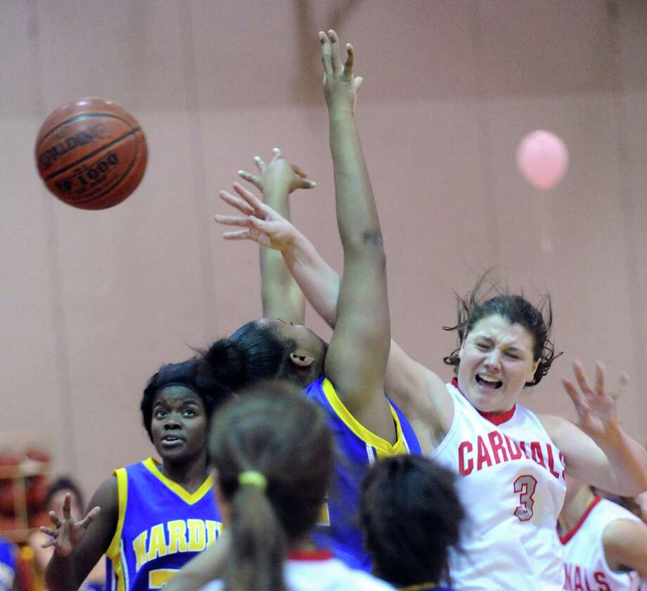 Caroline Barrett # 3 of Greenwich passes the ball amongst a group of Harding players during the girls high school basketball game between Greenwich High School and Harding High School at Greenwich, Friday night, Jan. 25, 2013. Photo: Bob Luckey / Greenwich Time