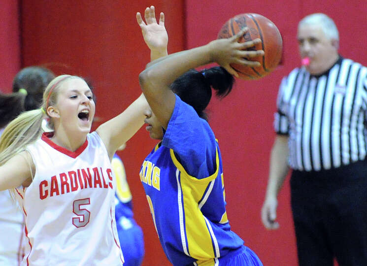 Rebecca DeCarlo, left,# 5 of Greenwich, defends a Harding passer during the girls high school basket