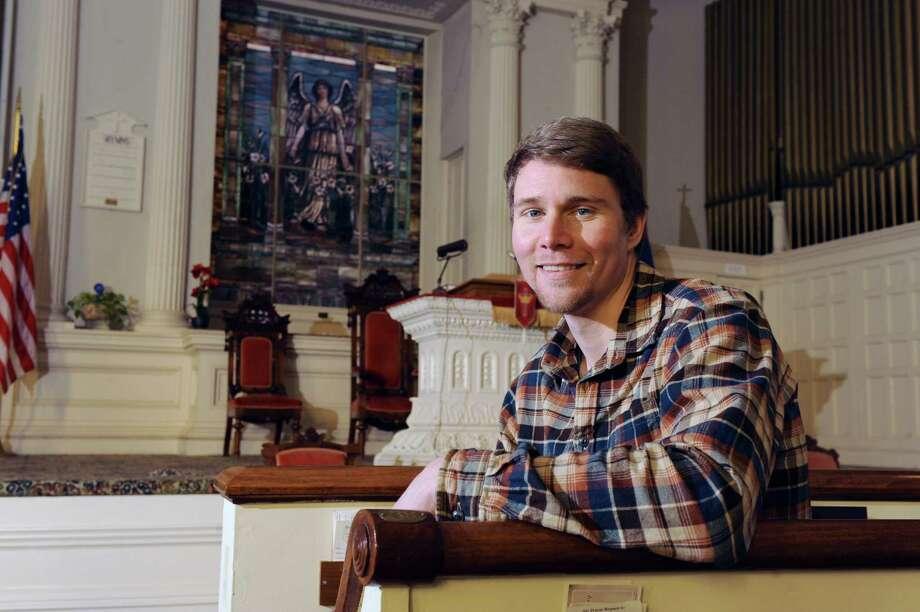 Pastor Daniel Williams sits inside the Terra Nova Church on Wednesday Jan. 23, 2013 in Saratoga Springs, N.Y.  (Lori Van Buren / Times Union) Photo: Lori Van Buren