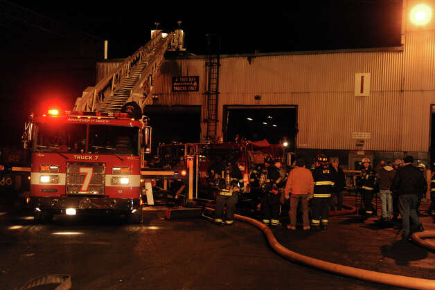 Ansonia firefighters at the scene of a fire at the Ansonia Copper and Brass Company factory, in Ansonia, Conn., Jan. 25th, 2013. Photo: Ned Gerard / Connecticut Post