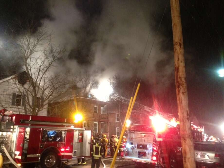 Firefighters attack a blaze at South 3rd Street in Mechanicville Friday night.(Paul Nelson/Times Union)
