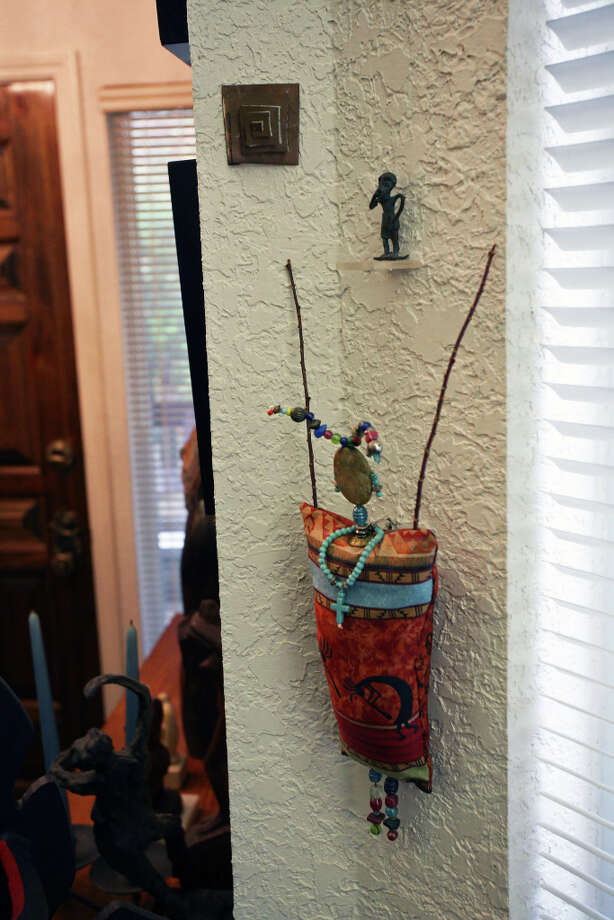 A narrow wall near the entry is decorated with small art pieces. Photo: Danny Warner