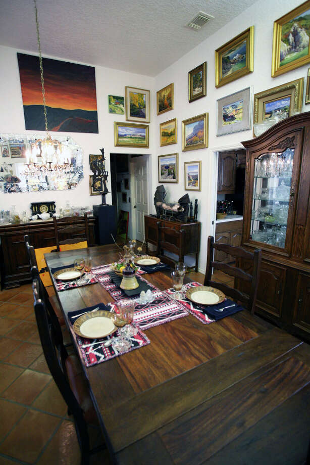 Landscape paintings dominate the dining room. Photo: Danny Warner