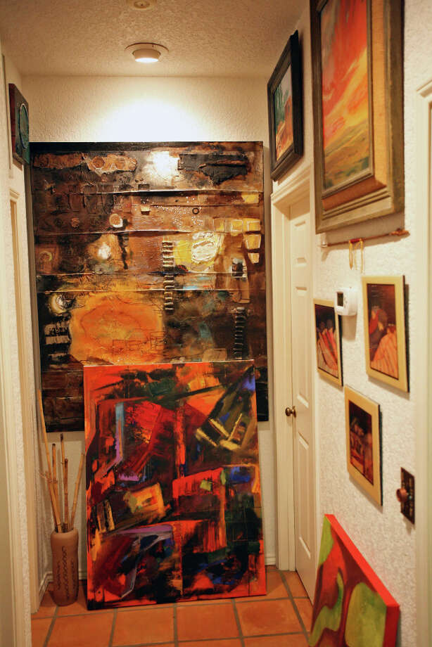 The hallway is filled with paintings. Photo: Danny Warner