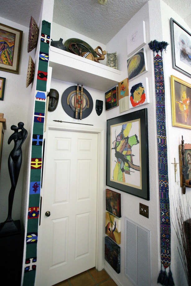 Sherry Cardenas says no wall is too small for art; estolas flank a doorway in the living room. Photo: Danny Warner