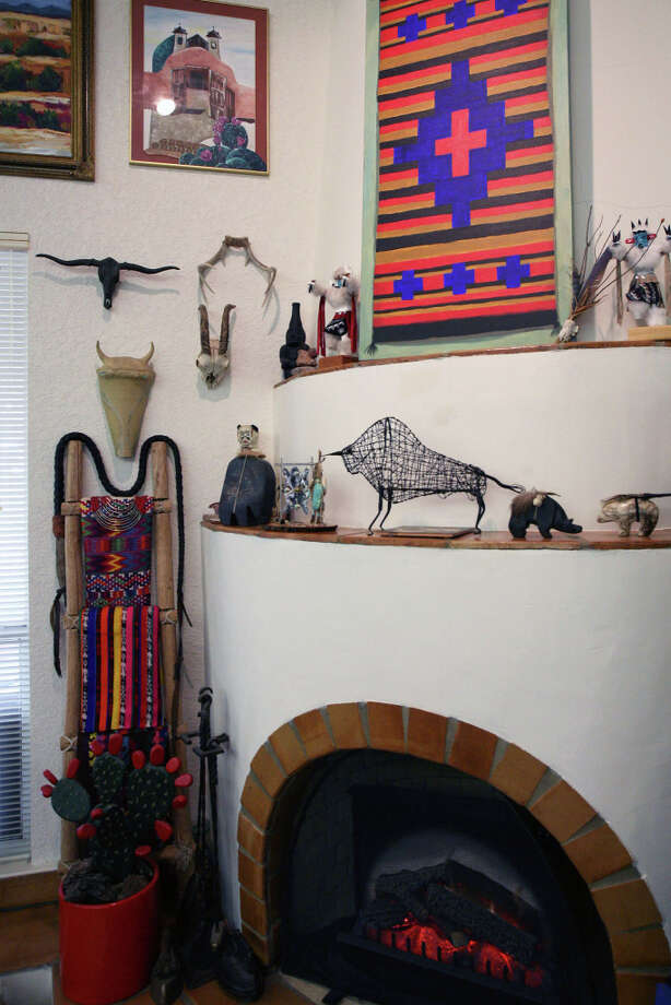 American art sits on two ledges of the Santa Fe-style fireplace that the Cardenases had built in their Hollywood Park home. Photo: Danny Warner