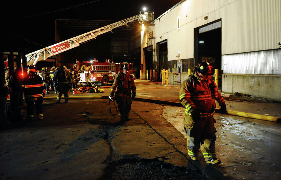 Firefighters on the scene of a blaze inside a building which is part of Ansonia Copper and Brass in Ansonia, Conn. on Friday January 25, 2013. Photo: Christian Abraham / Connecticut Post