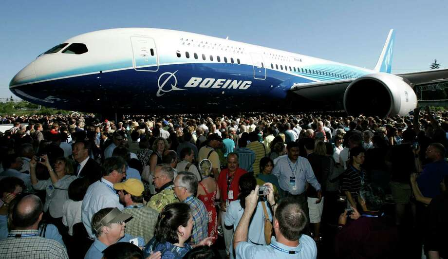 FILE - In this July 8, 2007, file photo, visitors  look at and take photos of the first production model of the new Boeing 787 airplane after it was unveiled to an audience of several thousand at Boeing's assembly plant in Everett, Wash. The Boeing 787 was a plane that promised to be lighter and more technologically advanced than any other, but once production started, the gap between vision and reality quickly widened. The jet that was eventually dubbed the Dreamliner became plagued with manufacturing delays, cost overruns and sinking worker morale. (AP Photo/Ted S. Warren, File) Photo: Ted S. Warren