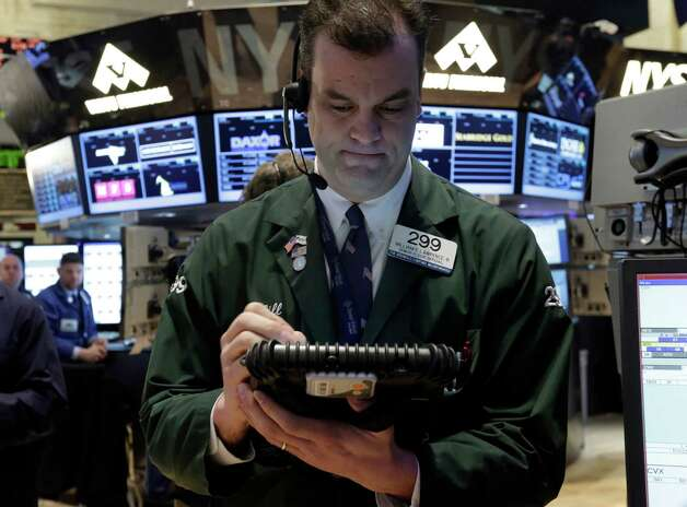 Trader William Lawrence works on the floor of the New York Stock Exchange, Friday, Jan. 25, 2013. Stocks are opening higher on Wall Street ahead of what is expected to be more upbeat data on housing from the government. (AP Photo/Richard Drew) Photo: Richard Drew