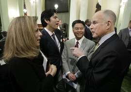 Gov. Jerry Brown, right, gestures to make his point  while talking with his wife, Anne Gust Brown, and State Senators Kevin deLeon, D-Los Angeles, second from left, and Ted Lieu, D-Torrence following his State of the State address at the Capitol in Sacramento, Calif., Thursday, Jan. 24, 2013.   Brown delivered a State of the State address that laid out the legacy-building ideas he will work on during the second part of his term, including K-12 education reform, high-speed rail and the largest upgrade to the state't water-delivery system in decades. (AP Photo/Rich Pedroncelli)