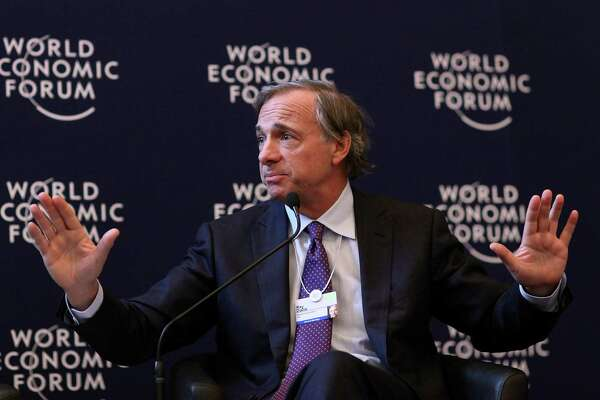 """Raymond """"Ray"""" Dalio, president and founder of Bridgewater Associates LP, speaks during a press conference on day one of the World Economic Forum (WEF) in Davos, Switzerland, on Wednesday, Jan. 25, 2012. The 42nd annual meeting of the World Economic Forum will be attended by about 2,600 political, business and financial leaders at the five-day conference. Photographer: Chris Ratcliffe/Bloomberg *** Local Caption *** Ray Dalio"""