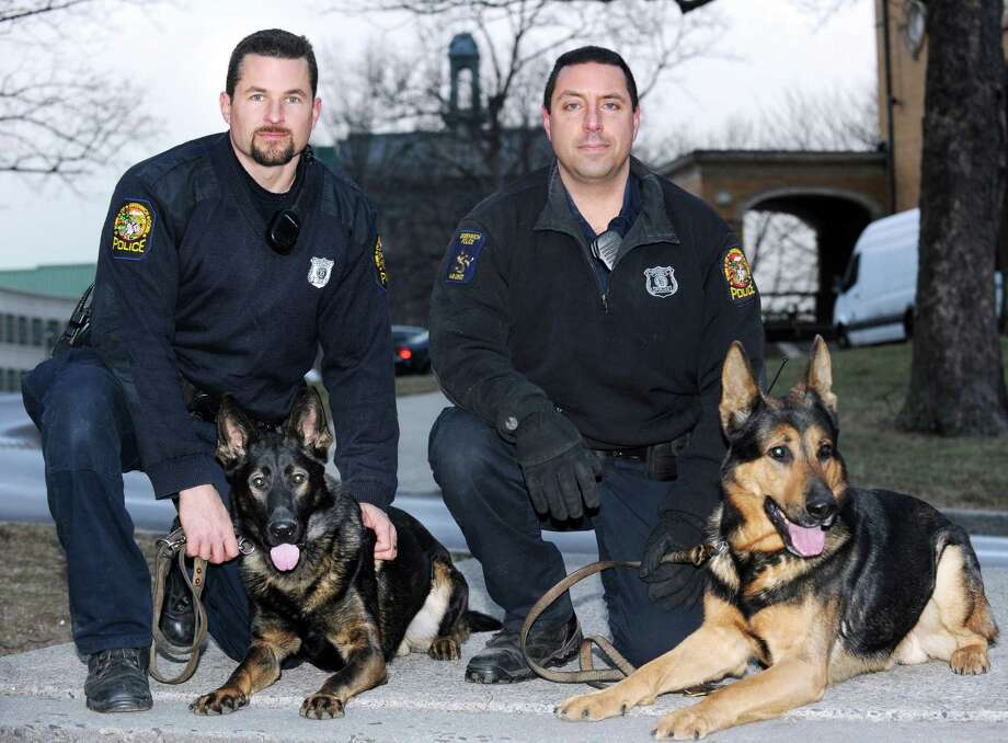 Greenwich Police K-9 Unit Officers Robert Smurlo, left, with his police dog, Altos, a German shepherd, and Mike Macchia and his police dog, Tyro, also a German shepherd, at Havemeyer Field in Greenwich, Friday afternoon, Jan. 25, 2013. Photo: Bob Luckey / Greenwich Time