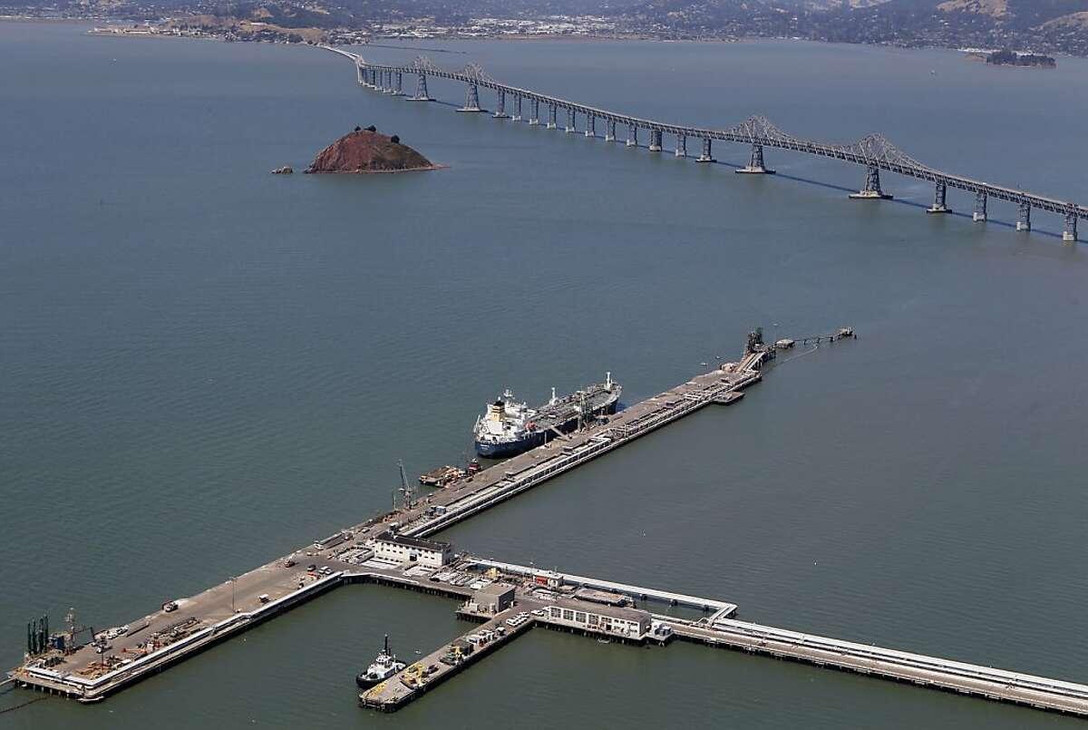 An oil tanker is docked at the Chevron refinery's long wharf near the Richmond-San Rafael Bridge in Richmond, Calif. on Tuesday, Aug. 7, 2012.