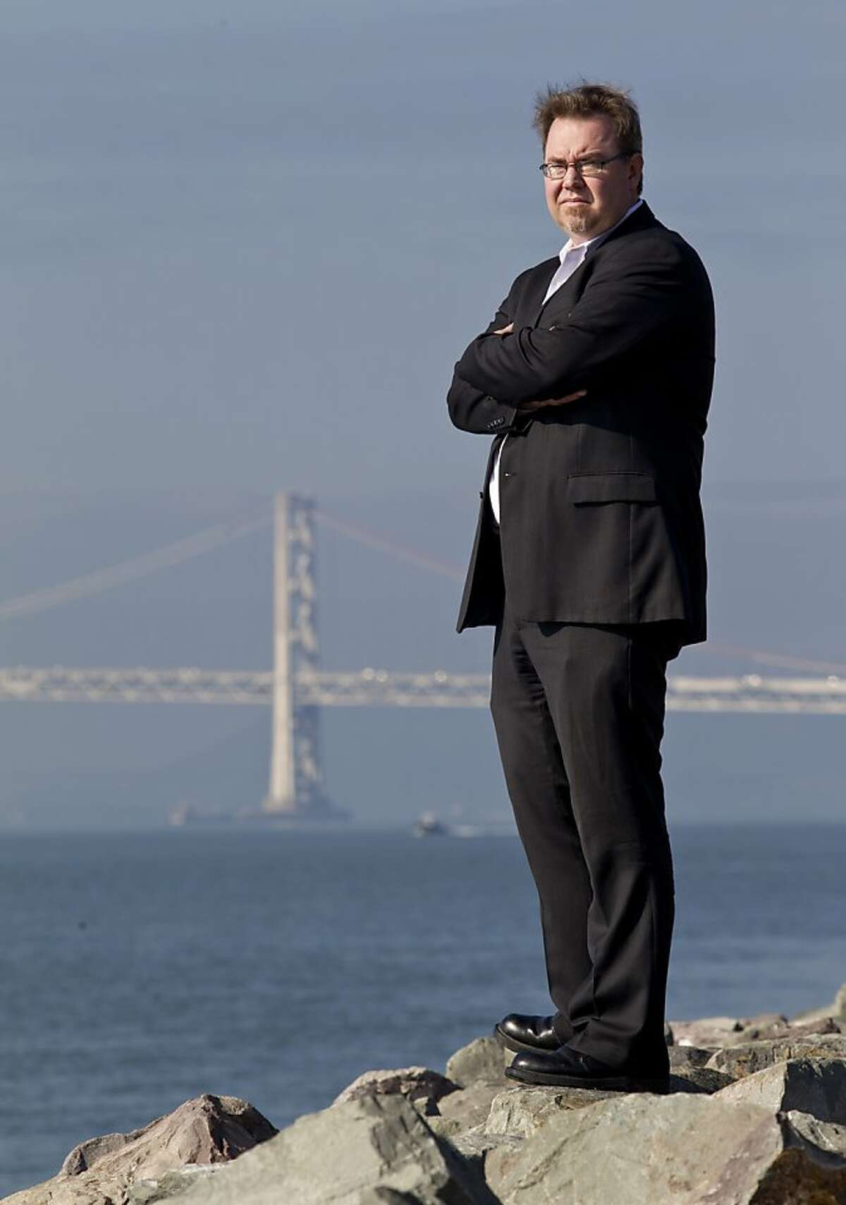 Michael Jacob, an official with the Pacific Merchant Shipping Association trade group, poses on the shore of the Oakland Ports on Friday, January 25, 2013 in Oakland, Calif.