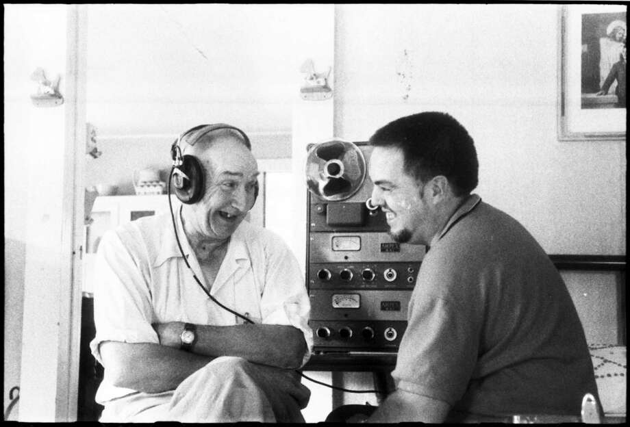 Wade Ward listening to playback with Alan Lomax at the Ward home, Galax, VA, August 31, 1959. Photo: Library Of Congress / Library of Congress