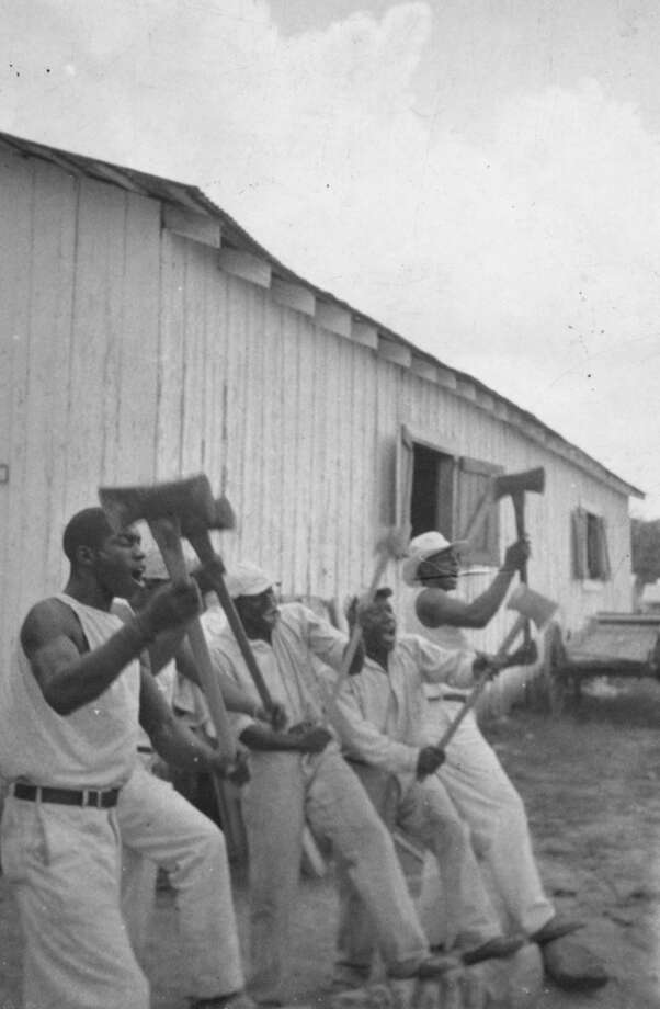 """Lightnin'"" Washington and other inmates sing as they work at Brazoria County's Darrington Prison Farm. Photo: Library Of Congress / handout web"