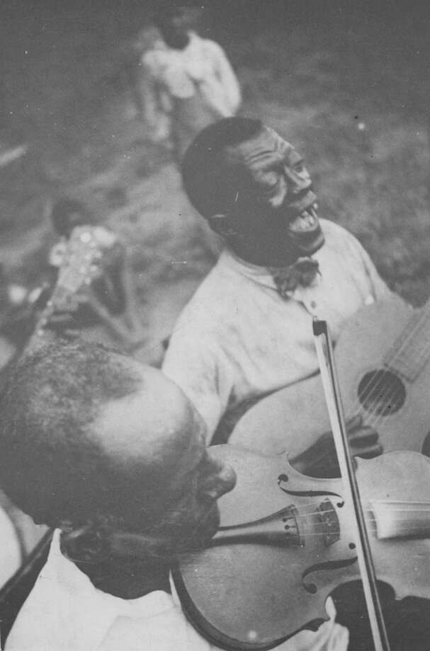 "Guitarist ""Stavin' Chain"" and unidentified fiddler offer raucous rendition of the ballad ""Batson"" at Lafayette, La., Photo: Library Of Congress, / Library of Congress,"