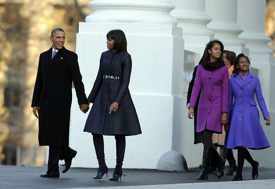 Obama daughters Malia and Sasha (right) are pretty in purple on the way to the reviewing stand for their father's inaugural parade. Photo: Rod Lamkey Jr., AFP/Getty Images