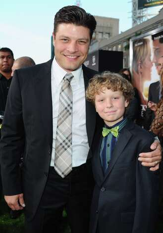 Jay R. Ferguson (left) with actor Riley Thomas Stewart at the premiere of their movie 'The Lucky One' in 2012. Photo: Alberto E. Rodriguez, Getty Images / 2012 Getty Images