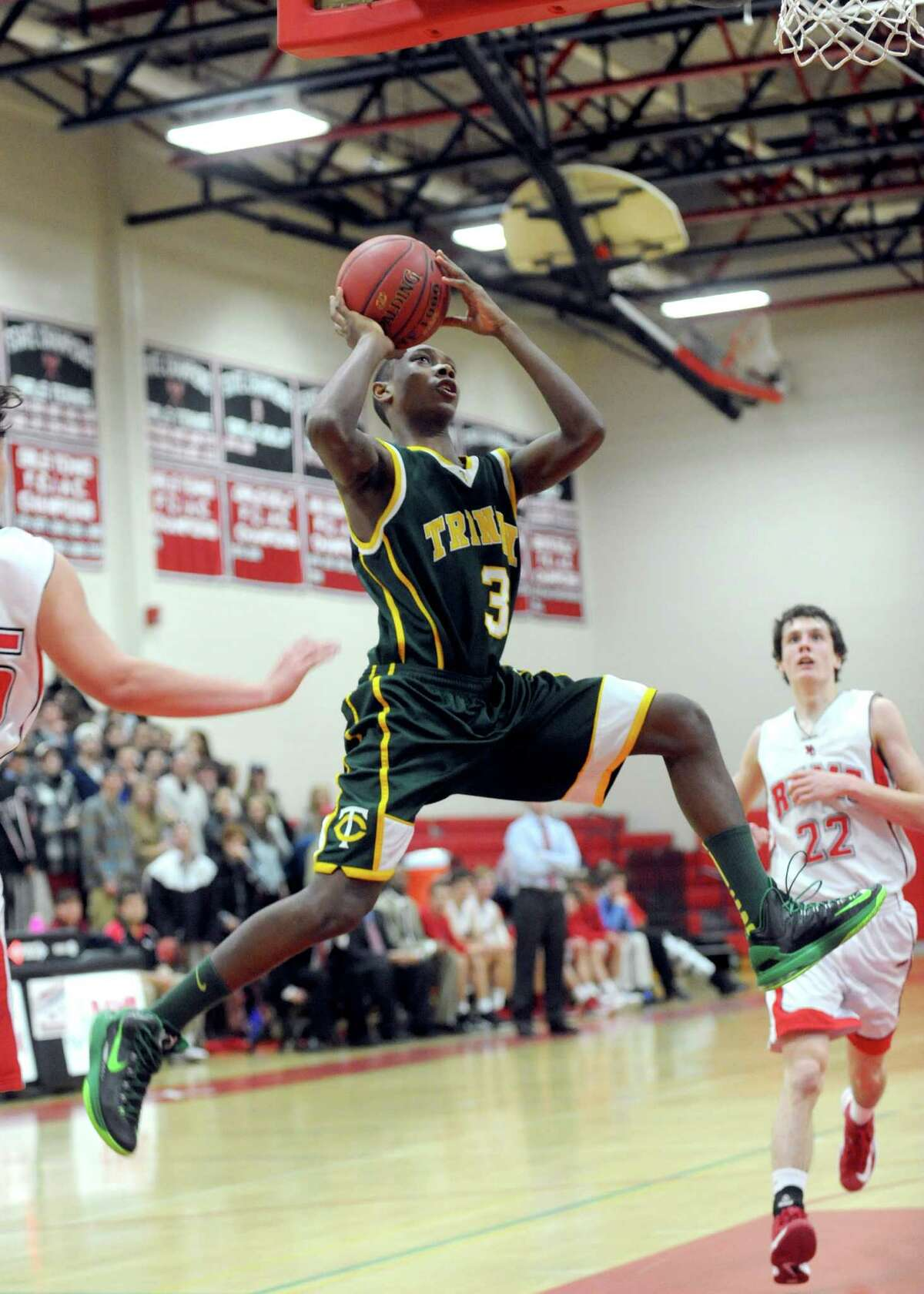 Trinity Catholic's Tremaine Fraiser takes a shot during Friday's boys basketball game at New Canaan High School on January 25, 2013.