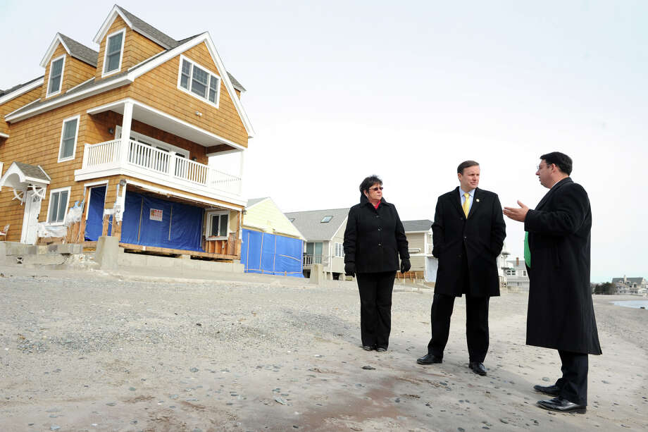 Senator Chris Murphy, center, stands with Mayor Ben Blake and State Rep. Kim Rose during a tour of Bayview Beach, in Milford, Conn., Jan. 25th, 2013. Photo: Ned Gerard / Connecticut Post