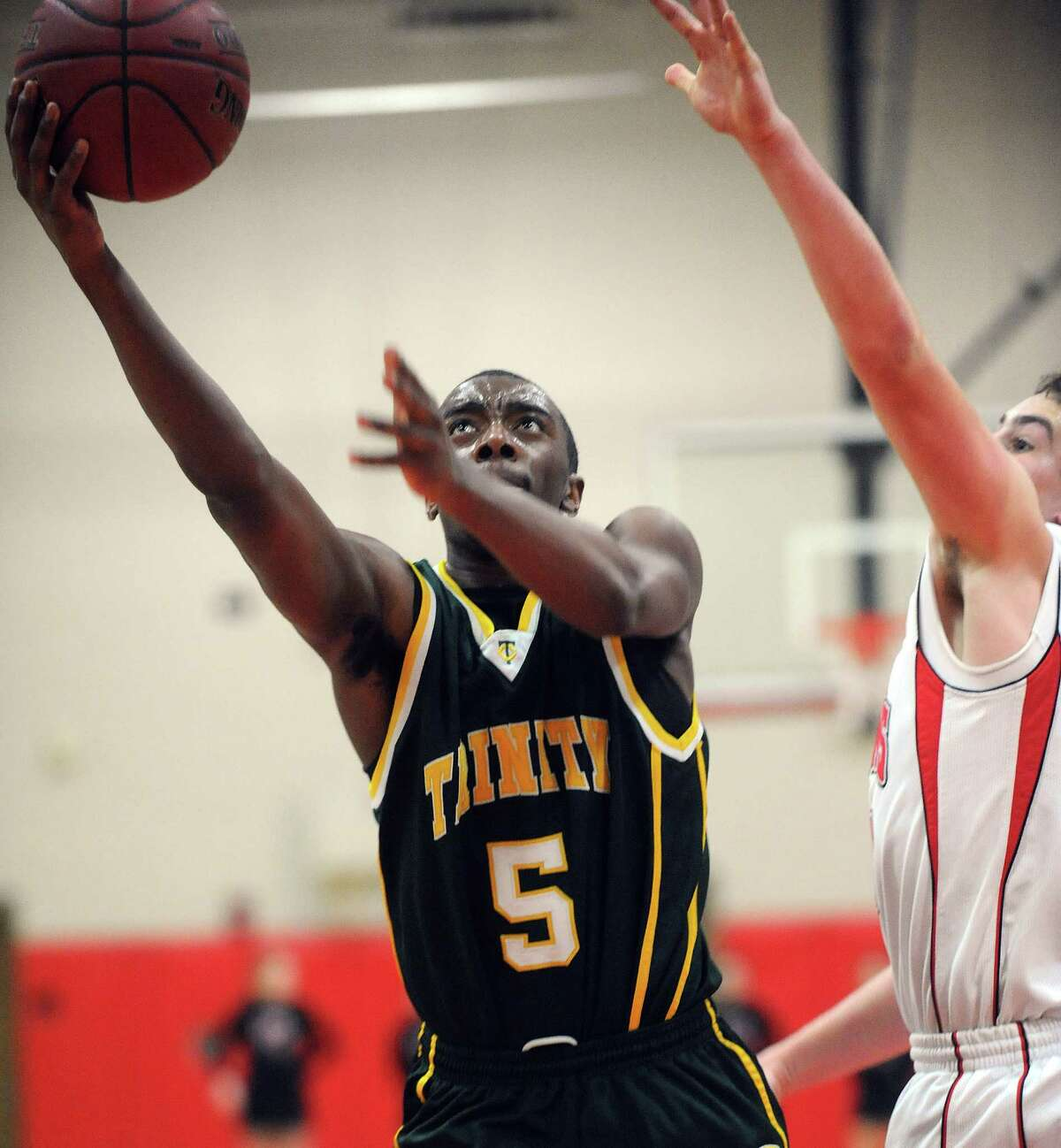 Trinity Catholic's Brandon Wheeler takes a shot during Friday's boys basketball game at New Canaan High School on January 25, 2013.
