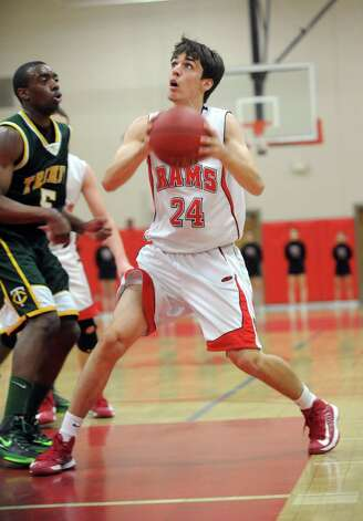 New Canaan's Christopher DeWaele takes a shot during Friday's boys basketball game against Trinity Catholic at New Canaan High School on January 25, 2013. Photo: Lindsay Perry / Stamford Advocate