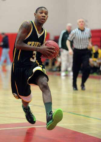 Trinity Catholic's Tremaine Fraiser controls the ball during Friday's boys basketball game at New Canaan High School on January 25, 2013. Photo: Lindsay Perry / Stamford Advocate