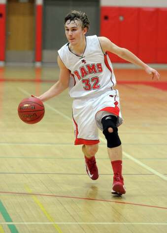 New Canaan's Erik Jager dribbles the ball during Friday's boys basketball game at New Canaan High School on January 25, 2013. Photo: Lindsay Perry / Stamford Advocate