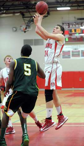 New Canaan's Zachary Allen takes a shot during Friday's boys basketball game against Trinity Catholic at New Canaan High School on January 25, 2013. Photo: Lindsay Perry / Stamford Advocate