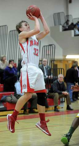 New Canaan's Erik Jager takes a shot during Friday's boys basketball game against Trinity Catholic at New Canaan High School on January 25, 2013. Photo: Lindsay Perry / Stamford Advocate