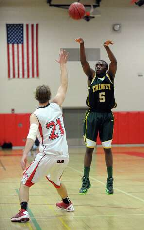 Trinity Catholic's Brandon Wheeler takes a shot during Friday's boys basketball game at New Canaan High School on January 25, 2013. Photo: Lindsay Perry / Stamford Advocate