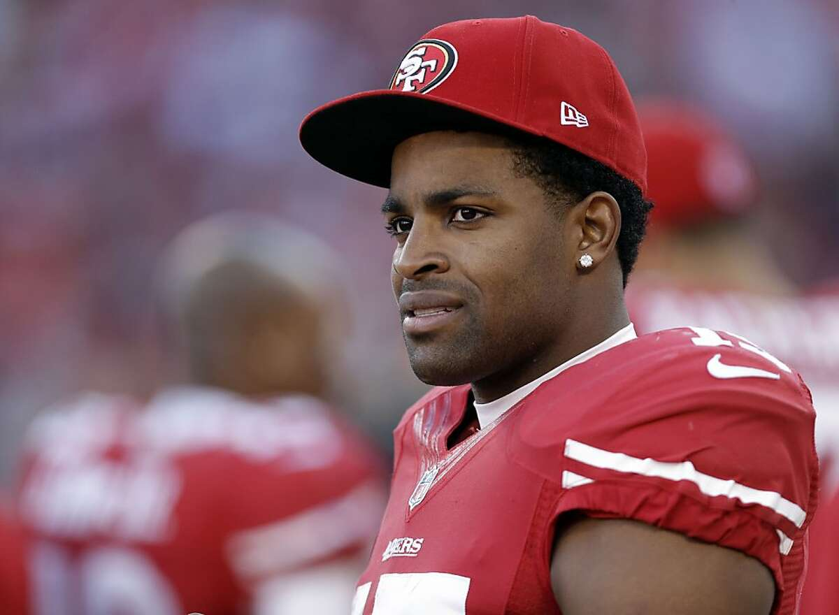 San Francisco 49ers wide receiver Michael Crabtree (15) looks on from the sideline during an NFL football game against the Arizona Cardinals in San Francisco, Sunday, Dec. 30, 2012. (AP Photo/Marcio Jose Sanchez)