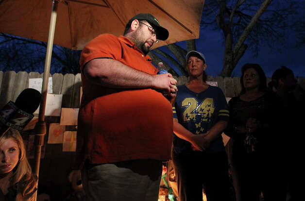 Troy Abrams pauses before he speaks during a neighborhood vigil about his deceased son Brandon. The boy had been waiting on the sidewalk for an ice cream truck to arrive when he was struck. Photo: Kin Man Hui, San Antonio Express-News / © 2012 San Antonio Express-News