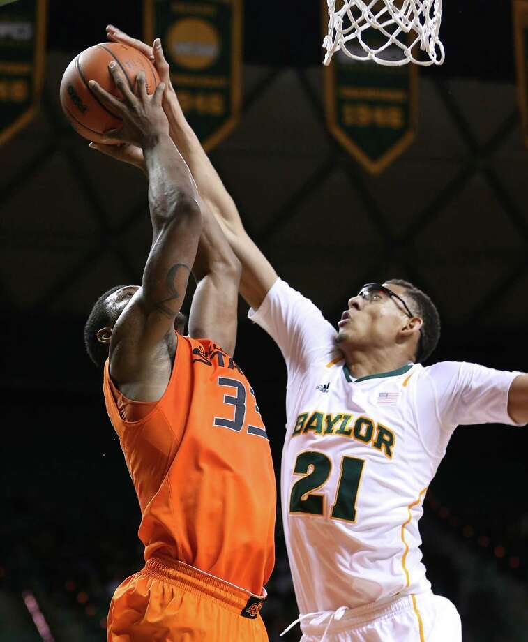 Baylor freshman Isaiah Austin (21) blocked five shots in Monday's 64-54 win over Oklahoma State, including this one against Marcus Smart. Photo: Rod Aydelotte, MBO / Waco Tribune Herald