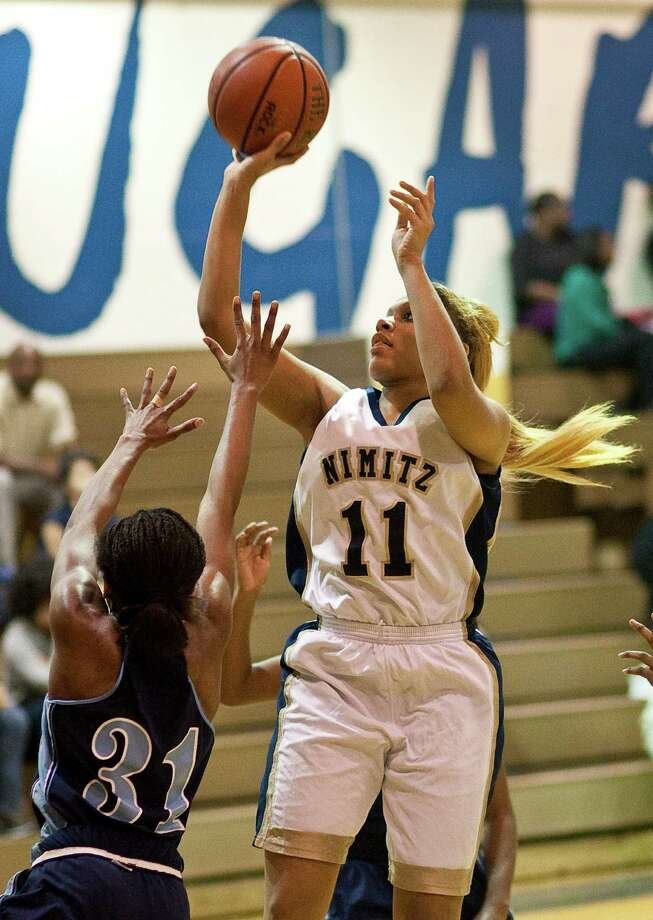 Elsik High School's Dashia Henry, left, is late to defend Nimitz High School's Shaqal Guidry during the second half of a high school basketball game, Friday, Jan. 25, at Nimitz High School in Houston. Photo: Nick De La Torre, Houston Chronicle / © 2013  Houston Chronicle