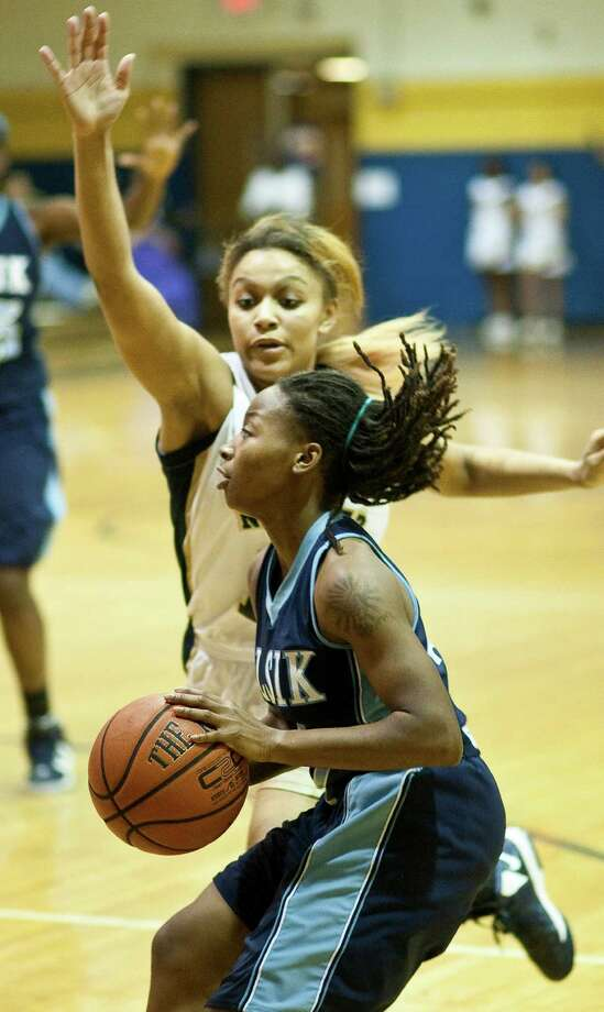 Elsik  High School Dashia Henry, front, drives past Nimits High School Shaqal Guidry for a running jumper during the first half half of a high school basketball game, Friday, Jan. 25, at Nimitz High School in Houston. Photo: Nick De La Torre, Houston Chronicle / © 2013  Houston Chronicle
