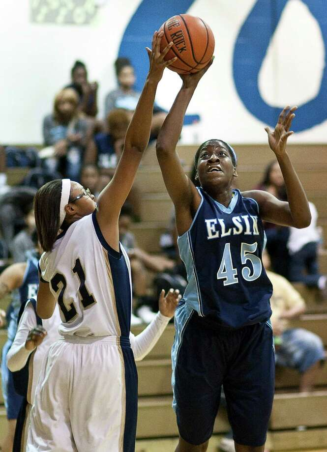 Nimitz High School's Briane Harrison, left, blocks Elsik High School's Jane Babammel's shot during the first half half of a high school basketball game, Friday, Jan. 25, at Nimitz High School in Houston. Photo: Nick De La Torre, Houston Chronicle / © 2013  Houston Chronicle
