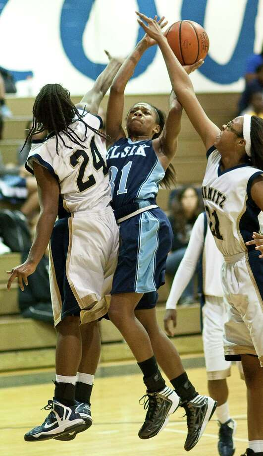 Elsik High School's Dashia Henry is fouled by Nimitz High School's Brianna Toney during the first half of a high school basketball game, Friday, Jan. 25, at Nimitz High School in Houston. Photo: Nick De La Torre, Houston Chronicle / © 2013  Houston Chronicle